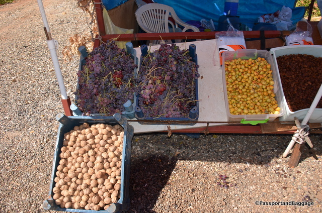Roadside stand, nuts and grapes with a small fruit that tastes just like an apple