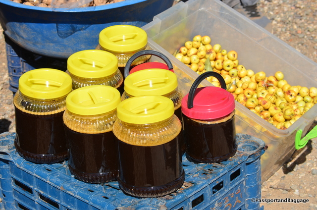 Grape Molasses for sale at a roadside stand