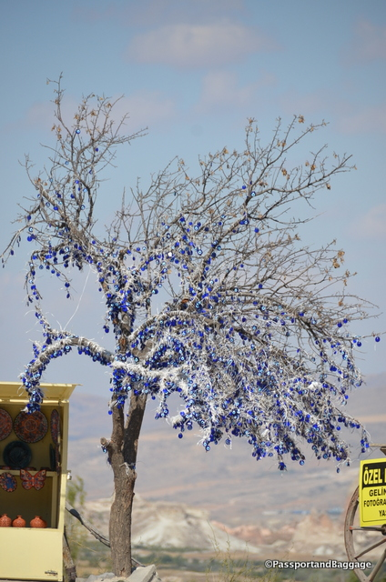 The evil eye is a superstition in much of this area, why hanging thousands of them in a dead tree is a mystery to me, but makes for a fabulous art statement