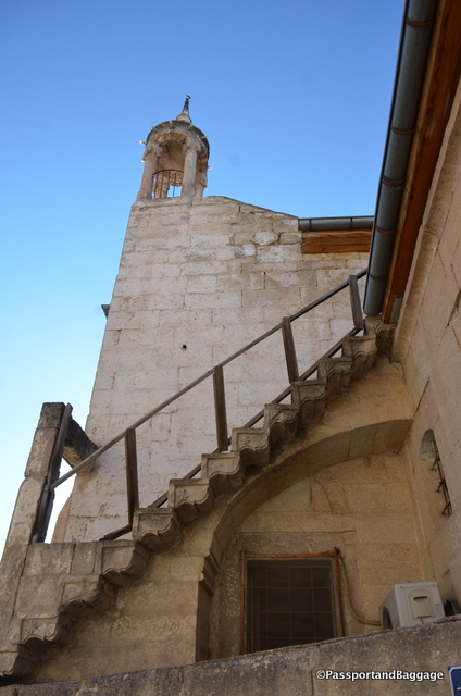 Stairways to an old bell tower than now holds the signs of a new religion