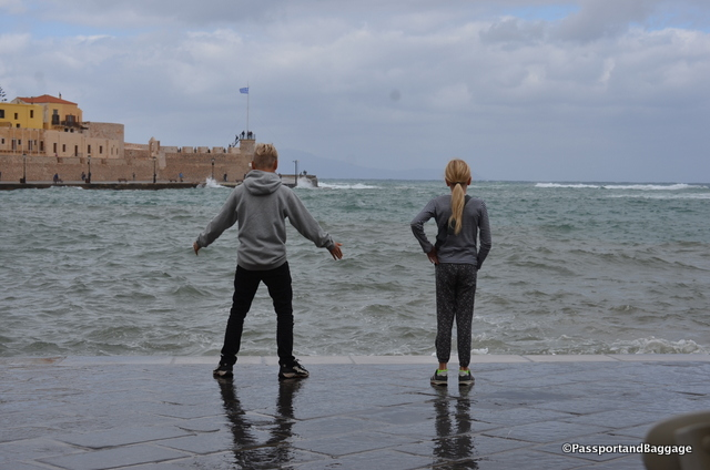 Two kids having fun with the splashing waves