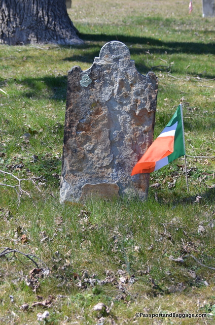 There are many illegible grave stones and all manner of flags