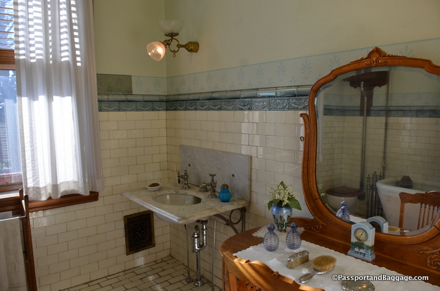 The second floor bathroom has a few areas that were left to show the neglect that occurred before the foundation was formed. The lack of cleaning can be seen in the small panel of blue above the tile that is a much darker color that the rest of the border.