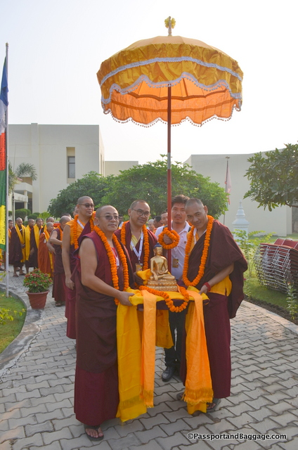 The day begins with a walk from SINI to the Stupa. The Chatra (umbrella) and the Buddha, as well as Buddha's words are all carried with reverence and respect to the ceremony.