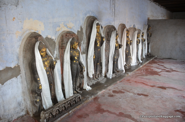 Peeking into the rooms of the Mahant's residence you find a Buddhist shrine. These are most likely statues that once stood in the Mahabodhi Temple