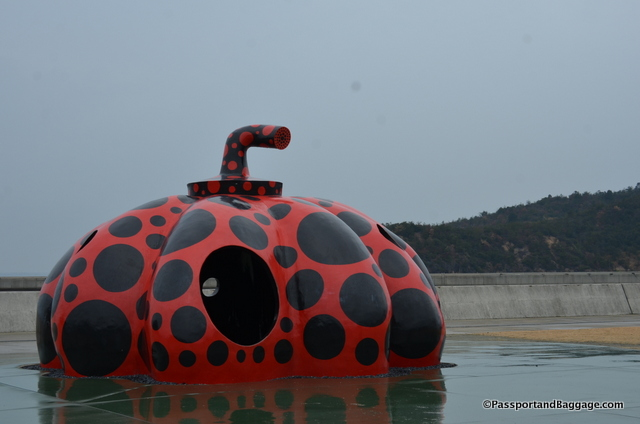 The red pumpkin by Yayoi Kusama greets you at the Miyanoura Ferry Terminal