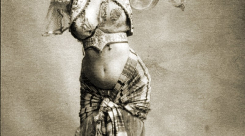 Woman in belly-dancing costume smoking