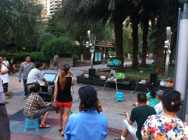 Outdoor karaoke at Jialing Park in Chongqing, China.