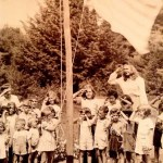 """Patsy"" age four raising the flag at a multi-family compound in Maine."