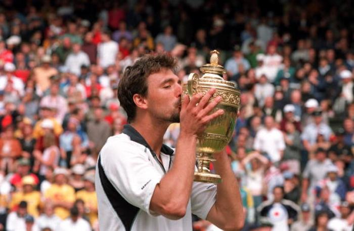 Tennis. 2001 All England Lawn Tennis Championships. Wimbledon. 9th July 2001. Mens Singles Final. Croatia's Goran Ivanisevic kisses the trophy after becoming the Mens Singles Champion, despite being a wild card entry, with a win over Australia's Pat Rafte