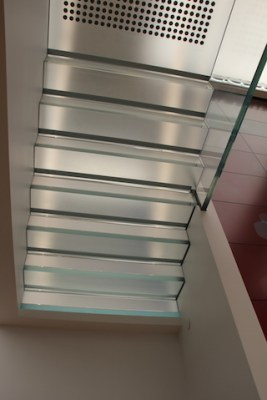 A narrow translucent staircase