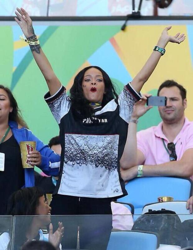 BsdFGrWIUAIoF5O Rihanna celebrated Germany winning the World Cup by lifting up her top [Picture]