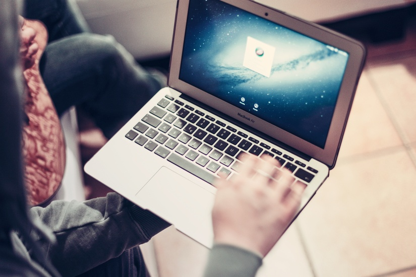 person-hand-apple-laptop-large