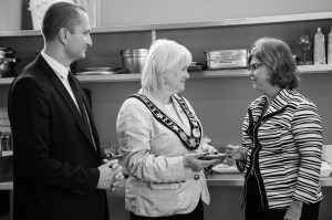 Tom Gancarz (left), Mayor Susan Fennell (middle) and Sharon Mayne-Devine, Executive Director of Catholic Family Services (right), share their dreams for the community kitchen at the Grand Opening.