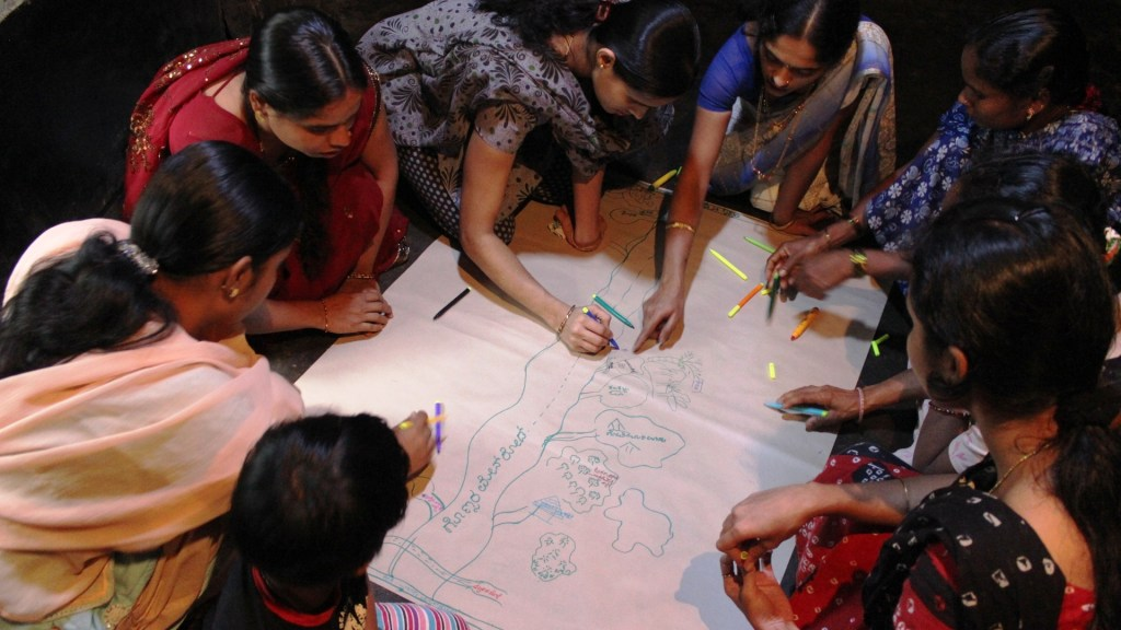 Participants create a Resource Map, showing the natural features of their landscape. Photo by Srinivas
