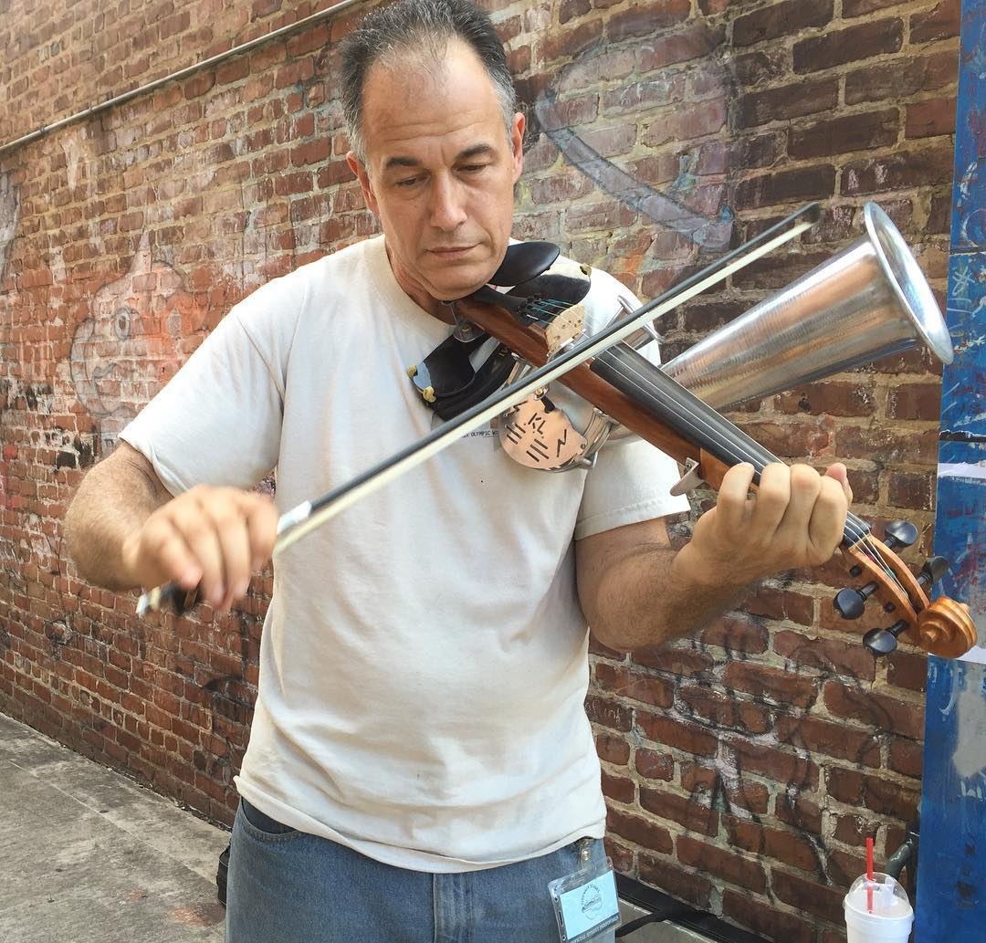 Paul playing a Stroh violin in Northshore district Chattanooga