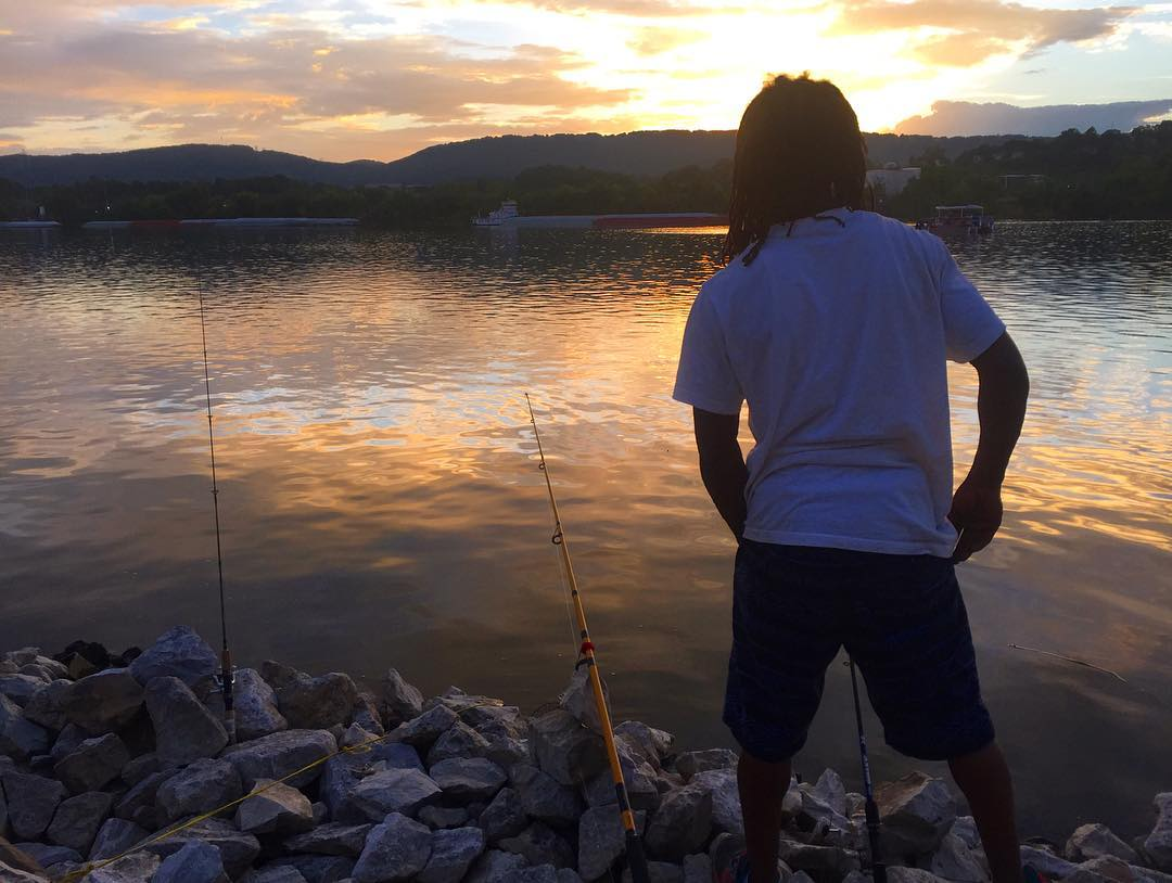 T fishing with his family down by the river