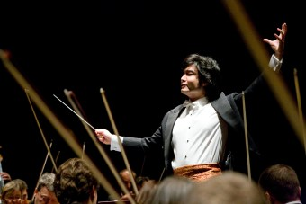 Man (Daryll Ang) orchestrating symphony