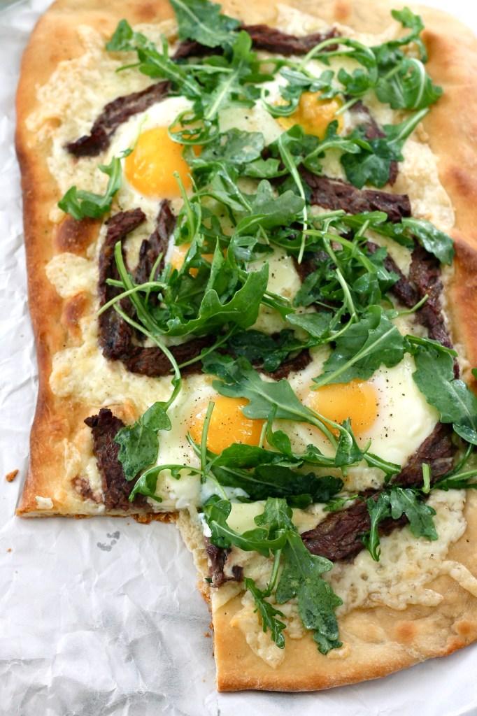 steak, egg, and arugula flatbread