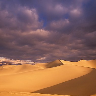 Dark clouds over sand dunes