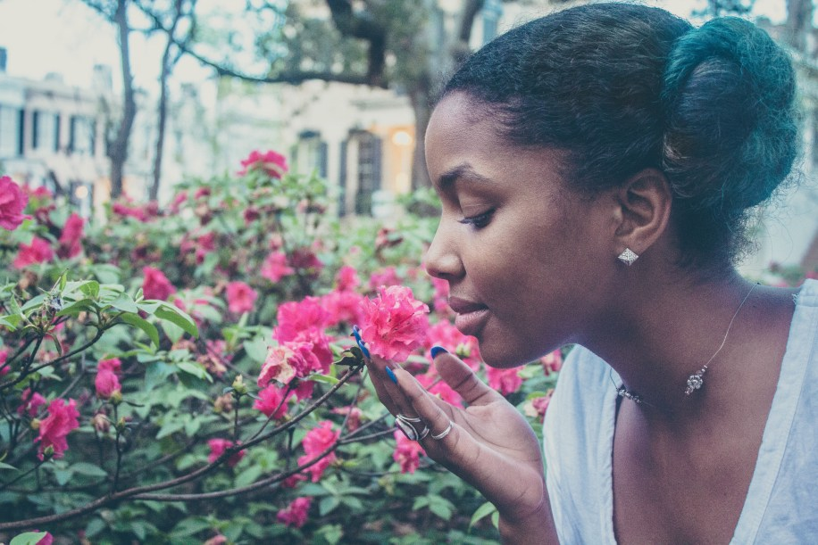 natural girl smelling flowers edit