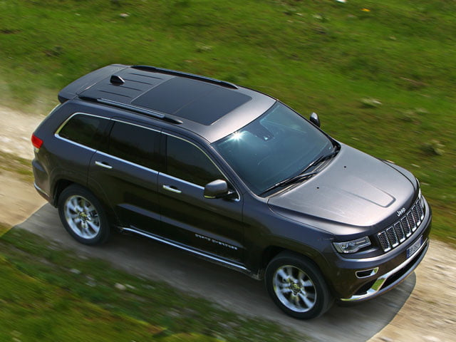 New 2013 Jeep Grand Cherokee on the road