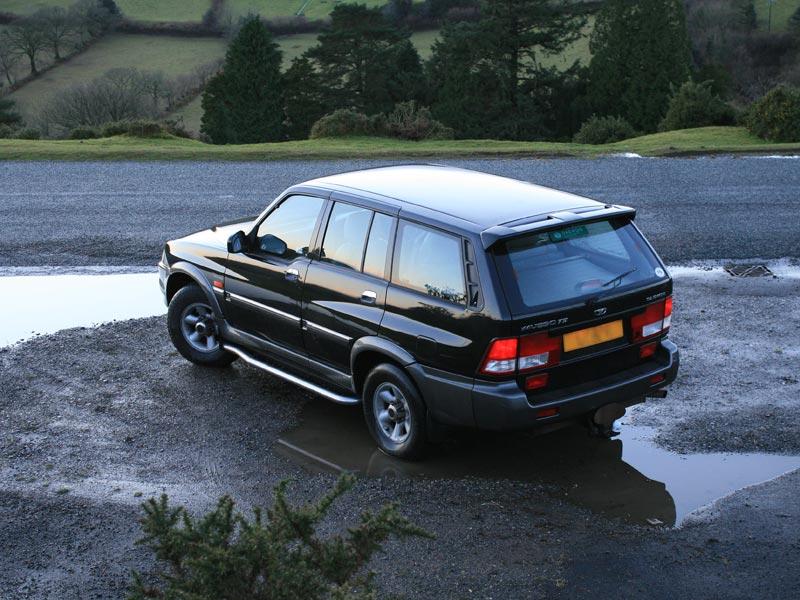 Rear of black 2002 Daewoo Musso