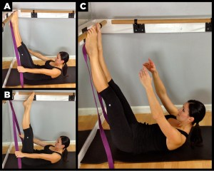 Woman exercising with bar.
