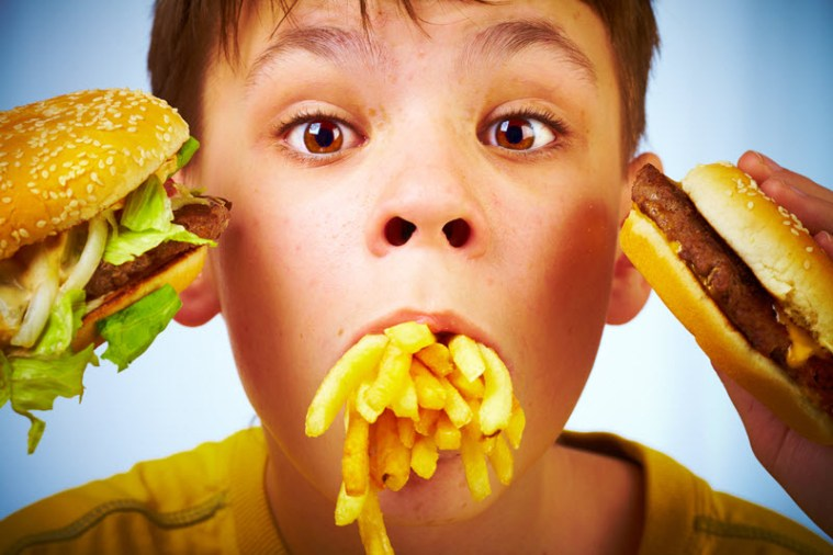 child and fast food -- result of relentless advertising