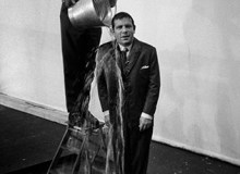 GB. England. Actor Norman Wisdom during a scene being shot at the Beaconsfield Film Studios. 1960.