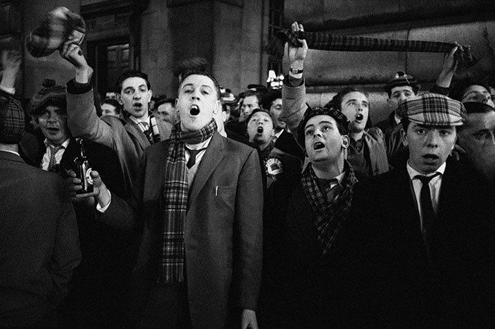 GB. England. Fans celebrating their team's win with beer in Piccadilly Circus. 1961.