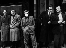 GB. ENGLAND. London. 1958. There had been a hanging that morning in Pentonville prison in north London. A group gathered outside the yet unopened pub opposite the main gate. The executed man had lived nearby and these were some of his friends.