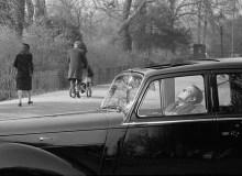 Hyde park – man asleep in car. London. England. 1963.