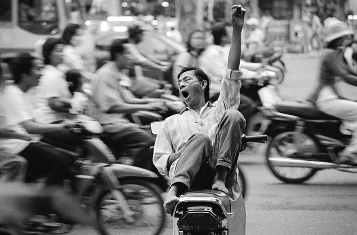 VIETNAM. As the pace of life picks up in the new Viet Nam, people relax wherever they can. Traffic in Viet Nam is chaotic and 97% of vehicles are motorbikes that kill well over a 1,000 people a month.