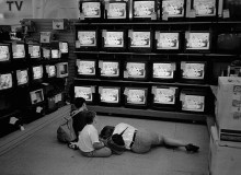 VIET NAM. Boys on their way home from school watching TV - the major way through which the children of Viet Nam are exposed to foreign values.