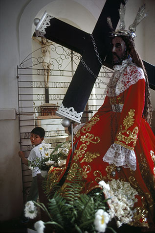 PHILIPPINES. Religion in the Philippines. A church in Manila with a black Christ.  1981.