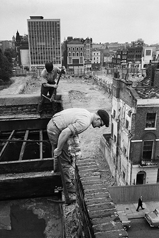 GB. England. Workmen demolishing buildings along Edgeware Road to make way for more profitable high-rise structures. 1962.