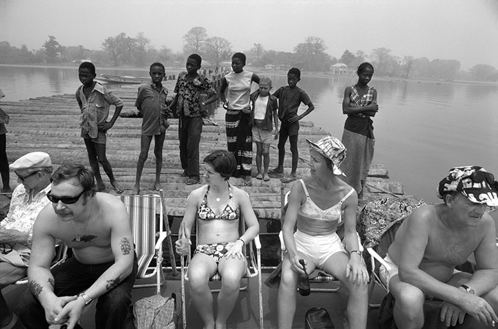 GAMBIA. On the riverbank in Gambia near Juffure, home of the slave Kunte Kinte of Roots fame. Nowadays, Swedish visitors have made this poor West African country a favoured tourist destination, especially for older single women who find the local men amenable. In earlier times, slaves were gathered on the island in mid-river before being shipped to the West Indies. 1978