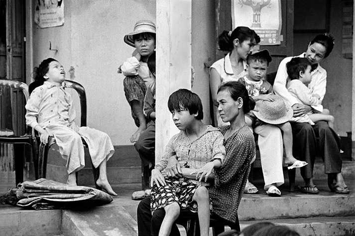 VIETNAM. Cam Nghia. Villagers with their affected children attend the health clinic for their weekly check-up. 1998