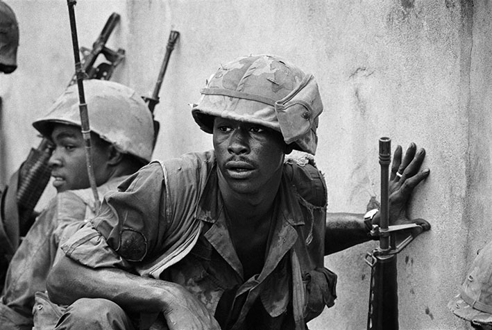 VIETNAM. The battle for Saigon. Scared looking marines crouch at a wall during Tet offensive. 1968