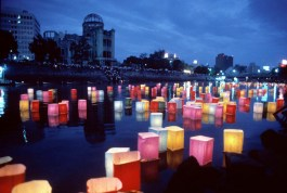 JAPAN. Hiroshima. 1995. Lanterns float on a river on the anniversary of the dropping of the atomic bomb.