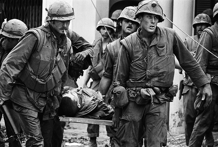 VIETNAM. Hue. US Marines inside the Citadel rescue the body of a dead Marine during the Tet Offensive. 1968