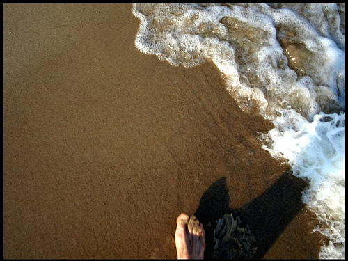 I love the feel of sand between my toes, and the constant sound of the waves breaking.
