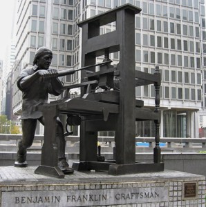 Benjamin Franklin with a printing press. Statue near City Hall, Philadelphia.
