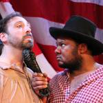 Ed Swidey as Uncle Tom and Langston Darby as Master Hardy in UNCLE TOM'S CABIN