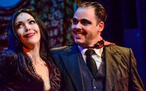 Morticia and Gomez (Jennie Eisenhower and Jeff Coon) share a goofy sexy and totally unique moment. Photo by Chris Jordan.