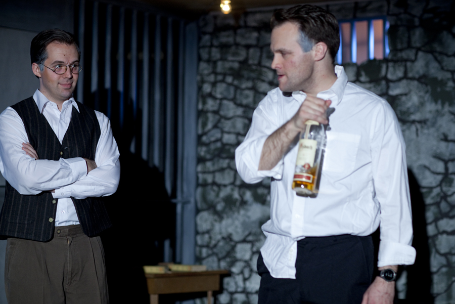Bonhoeffer (Chase Byrd) amused by the vicio. us Rott (Steve Underwood) getting drunk. Photo by  by © James Jackson.