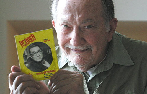 Walt Vail holding a playbill of his recent work Branch.  Photo by Tim Hawk.