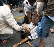 Medical teams work on a man shot dead by the Thai army under the Thailand Internal Security Act in 2010