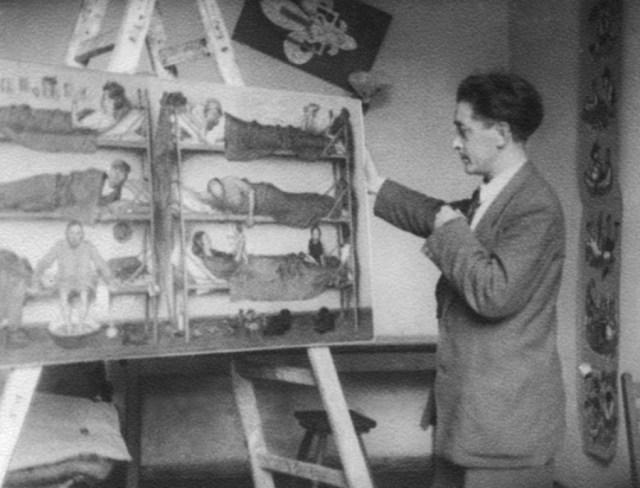 """Я. Гніздовський на фоні картини """"Переміщені особи"""". Фото з www.wikiwand.com"""